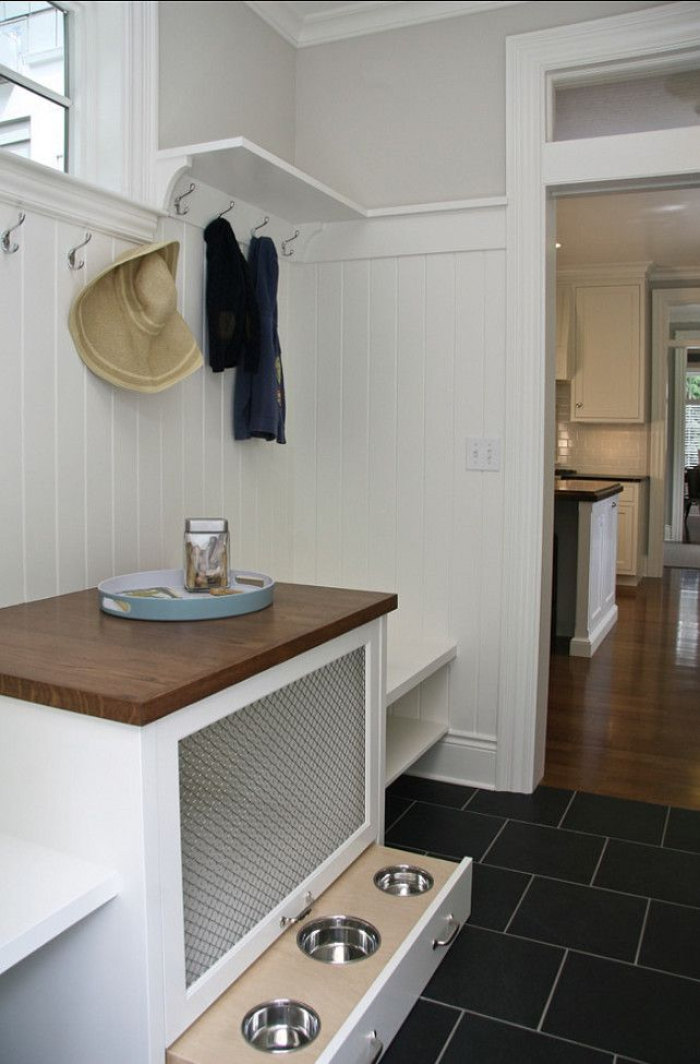 The mudroom is very practical with slate floors and a very smart pet cage and pull-out feeding station.