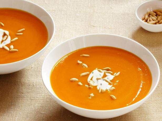 Ginger-Carrot Soup : Guy's creamy carrot soup is thick and rich, but has less than 200 calories per serving.