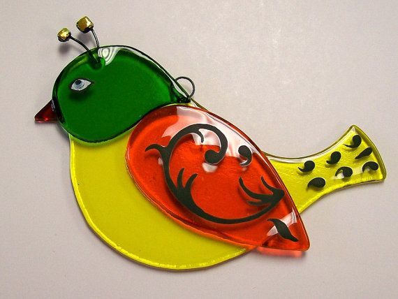This adorable little fused glass suncatcher is my newest addition. The bird was designed and created by me, CDChilds.  He would look perfect hanging in
