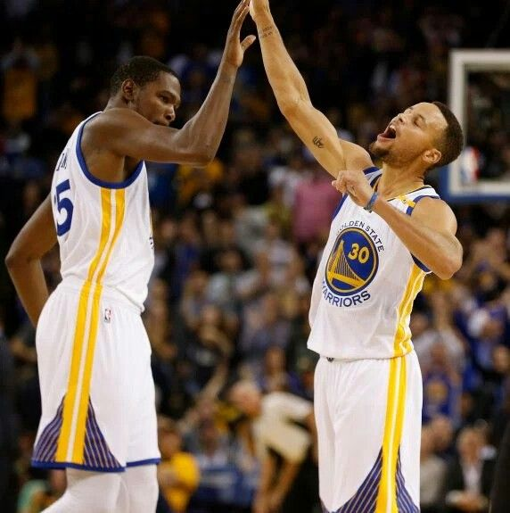 celebrates with Kevin Durant (35) after shooting his 13th 3-pointer in the fourth quarter of their NBA game against the New Orleans Pelicans at Oracle Arena in Oakland, Calif., on Monday, Nov. 7, 2016. Curry broke the NBA record for 3-pointers in the game.