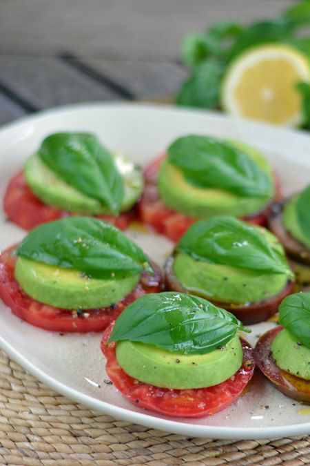 A paleo take on a Caprese salad with tomatoes and basil fresh from the garden. Heirloom tomato avocado salad is the perfect summer appetizer.   cookeatpaleo.com