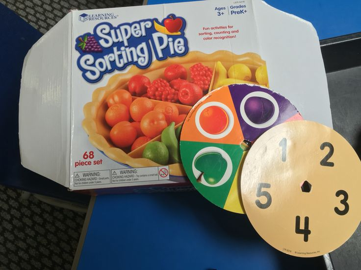 This is a game called 'super sorting pie' which is great for fine motor control, counting, number recognition and colours