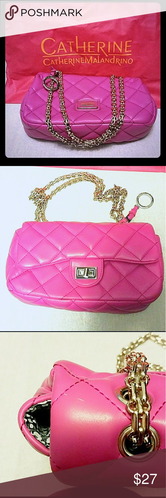 "Catherine Maladrino Pink Quilted Shoulder Bag. Faux leather hot pink quilted shoulder bag. On two small mark as seen in pic 2. I only used it once so otherwise it's in clean and beautiful shape. Still has dust bag. Length 10"", Width 3 and half inches, Height 6"". Ask any questions you may have💜 Catherine Malandrino Bags Shoulder Bags"