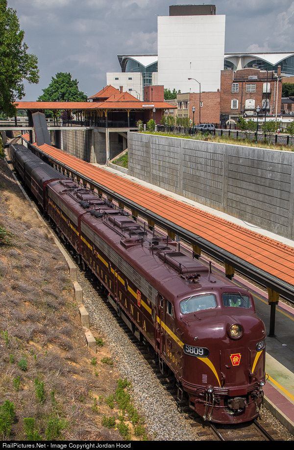 Bennett Levin's privately owned Pennsylvania Railroad trainset, including a matching pair of E8s and three cars, passes by the High Point Amtrak depot after a meet with hot intermodal 212 as they make their way towards the Streamliner's festival.