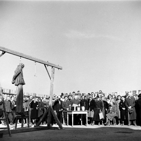 As German officers and Weimar civilians bear witness, after Buchenwald's liberation, to atrocities committed at the camp, a dummy in striped prisoner garb hangs from a gallows — a gruesome demonstration of one of the many public ways that inmates were murdered at the camp.: Atroc Commitment, April 1945, Gruesom Demonstrations, Garb Hanging, Buchenwald Liberalism, Prison Garb, German Offices, Civilian Bears, Bears Witness