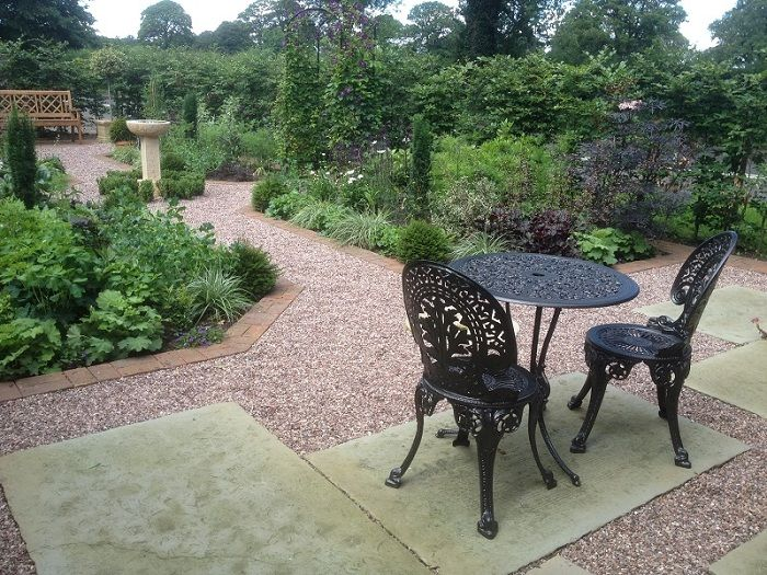 The use of reclaimed and traditional materials, like the York stone, blend beautifully with the period property. An old cast iron patio set was repainted to give it a facelift! www.ebgardendesign.co.uk