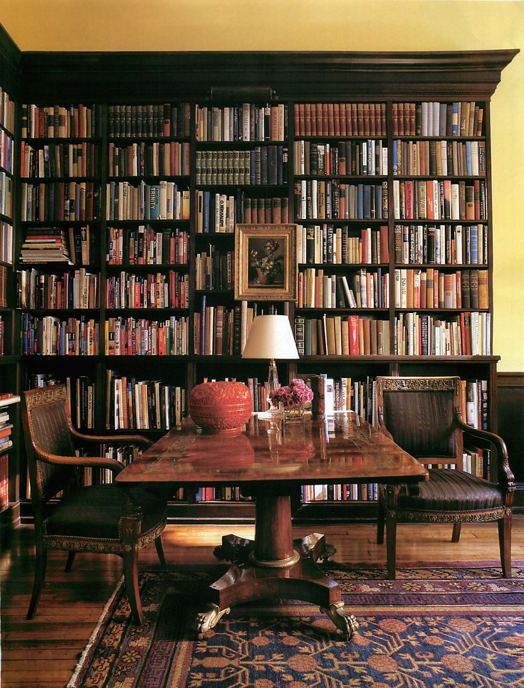 A classic English library with William IV library center table Architectural Digest