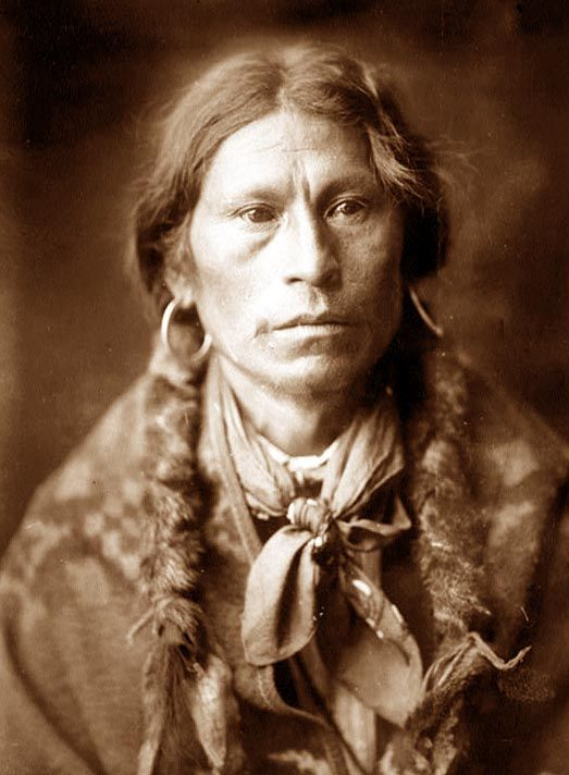"""Apache Chief    You are viewing an original photograph of an Apache Chief. The photo is by Curtis, and was taken in 1905. Curtis captioned the image, """"Jicarilla man""""."""