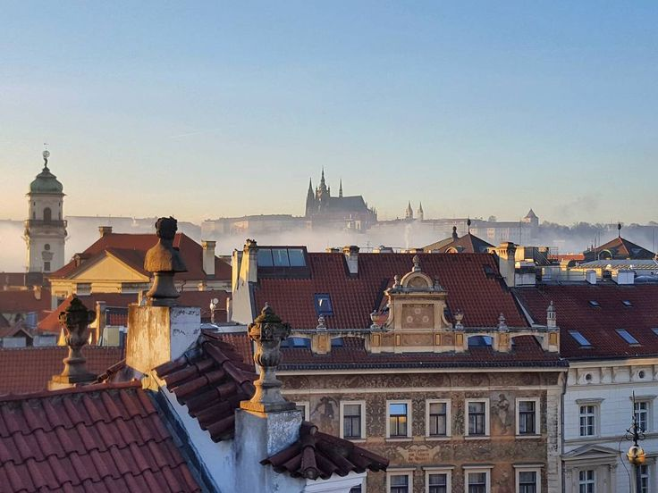 December Afternoon in Prague with the Prague Castle  #prague #travel #december #afternoon #roof #oldtown #castle #praguecastle #architecture #bluesky #street #streetphotography #galaxys6