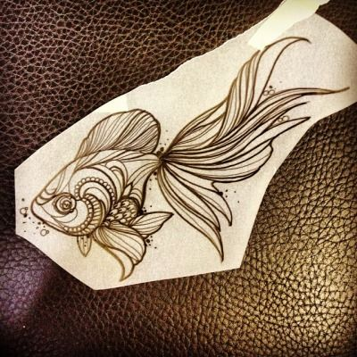 I wouldn't get a goldfish tattoo but it is a very pretty design