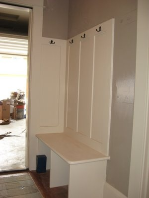 Storage boxes for the bench and bead board, hooks and pictures above. Perfect for the corner of the mudroom.