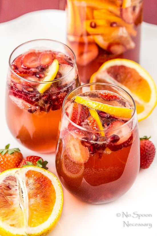 Champagne sangria with blood orange, pomegranate, and strawberry