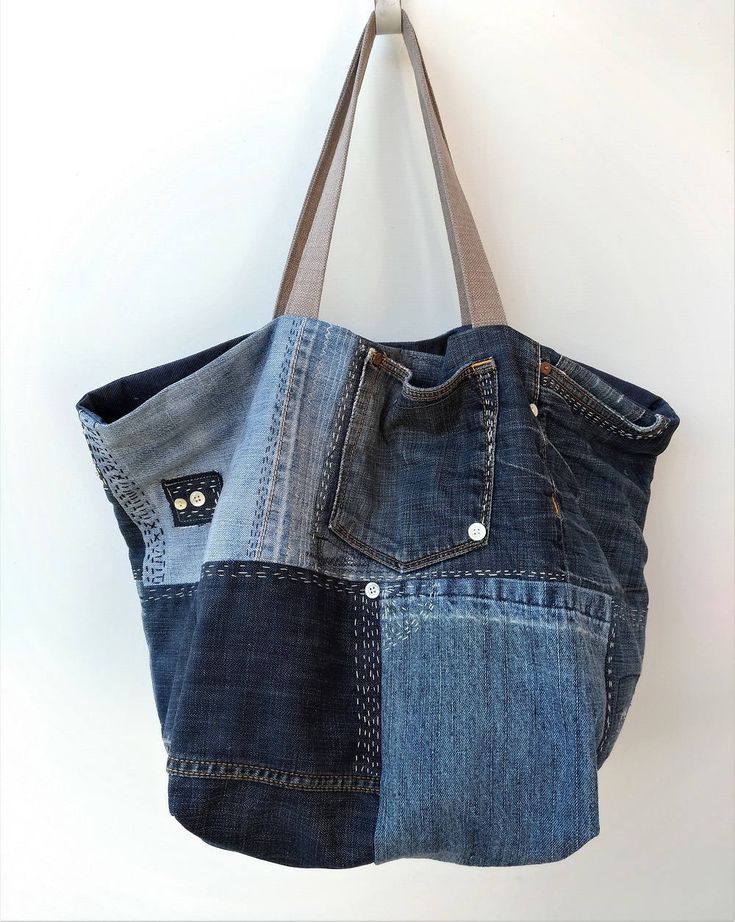 Large upcycled denim bag with hand embroidered sashiko details. This shoulder bag is made from three different jeans, I have combined best parts of them to create this unique bag. There are three pockets on the outside, its fully lined in a blue cotton fabric with one beige pocket