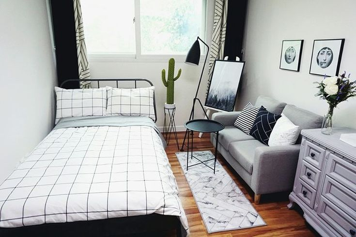 Try a different rug and remove that small stand. Good way to decorate a small room to your comfort honestly.
