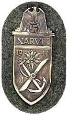 The Narvik Shield, was a WW II German military decoration awarded to all German forces that took part in the battles of Narvik between 9 April and 8 June 1940. It was instituted on 19 August 1940 by Adolf Hitler.The shield was hollow backed and stamped from sheet metal which was usually zinc, although a few early examples were made in brass.It was worn on the upper left arm of the uniform and each recipient was presented with three copies.In 1957 along with many other German decoration of…