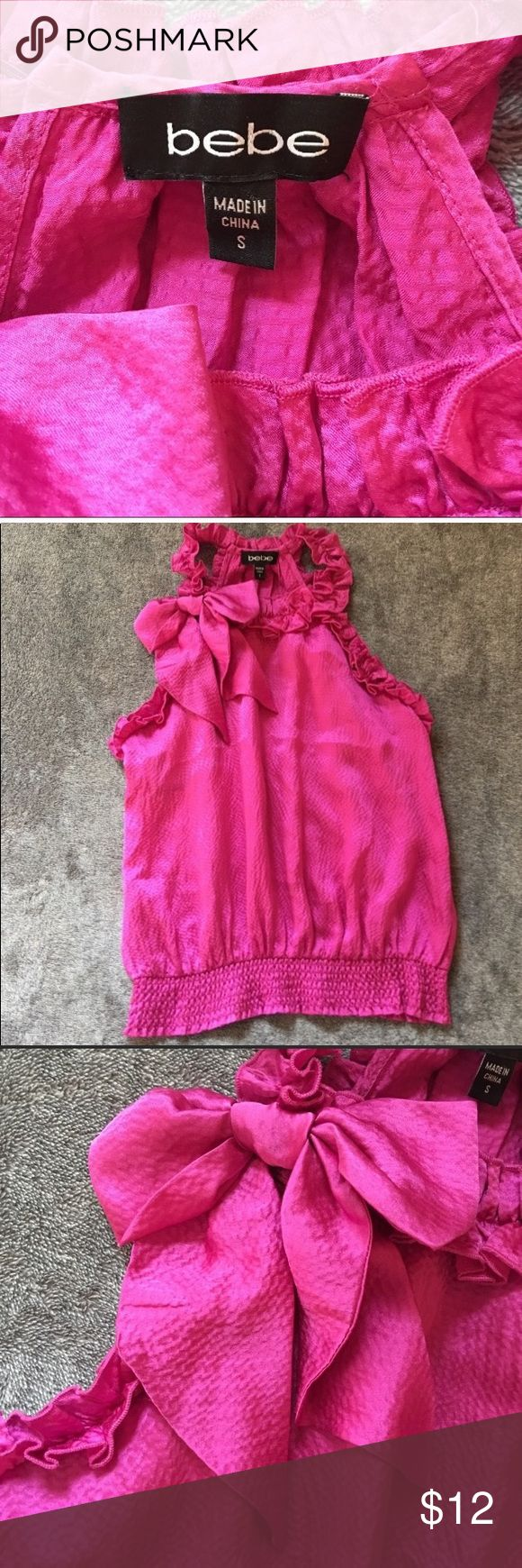 Bebe Bow Tank Top Beautiful Bebe top with bow that can can be left on or taken off. Purchased from another Posher for my daughter and she already had a top similar. Tops Tank Tops