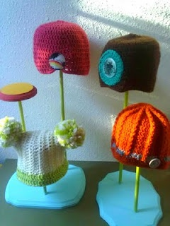 Neat homemade hat display- The different levels of hats would be so cute on top of the display case... :)