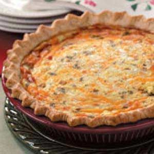 Chile Rellenos Quiche (Pastry for single-crust pie, cornmeal, Monterey Jack cheese, cheddar cheese, chopped green chilies, eggs, sour cream, fresh cilantro,  hot pepper sauce)