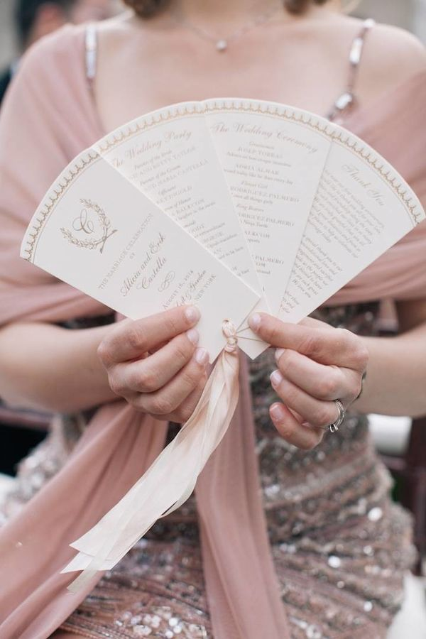 If you order this fan booklet wedding program in a very heavy paper, we suppose you might be able to use it to fan yourself. However, its main purpose is to allow a bunch of categorized content in a small, pretty package all tied up with a sweet ribbon.