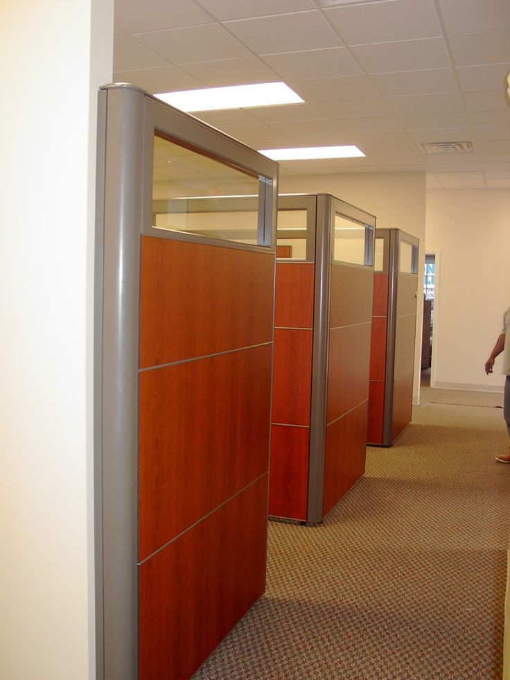 Cherry laminate panel cubicle workstations for a local design firm by connecting elements