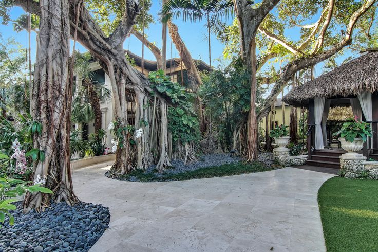 You can find endless tranquility just outside of Villa Dwora. The beautiful and palatial 100-year-old Banyan tree is the centerpiece of the lush resort-style backyard, making relaxation just around every corner.  #SupremeAuction #LuxuryAuction #Miami #CoralGables #MiamiMansion #MiamiRealEstate #Florida #FloridaRealEstate #ResortStyle #Auction #KoiPond #MediterraneanMansion