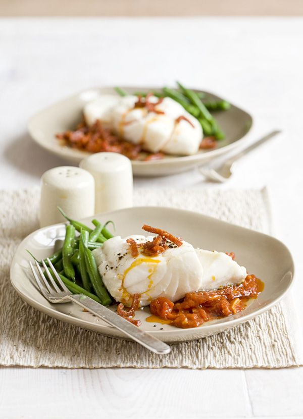 Cod with tomato and chorizo sauce: Chorizo is a brilliant ingredient - you just need a little to add a hit of smoky, spiciness to dishes. Here it's used to flavour a rich, garlicky tomato sauce which is served with a thick fillet of grilled cod for a healthy, flavour-packed supper for two.