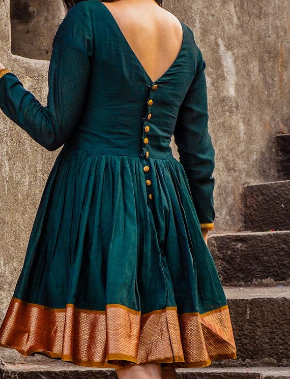 "This dress is crafted from traditionally hand woven Narayanpeth fabric, a vintage fabric for saris in India. This dress is created in eclectic colours featuring a zari border woven from golden threads. It has a V-neck in the front and pleats at the waist for a flirty flair. It features hand crafted buttons along a deep back. This dress is available in 4 sizes - SIZE BUST WAIST HIPS XS 32"" (81cm) 26"" (66cm) 36"" (91cm) S 34"" (86cm) 28""(71cm) 38""(96cm) M 36"" (91cm) 30""(76cm) 40""(101cm) L…"