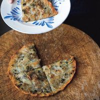 Potato Tart with Thyme - 1 stick (4 ounces) unsalted butter  2 pounds Yukon Gold potatoes  2 tablespoons fresh thyme leaves  Kosher salt and freshly ground pepper