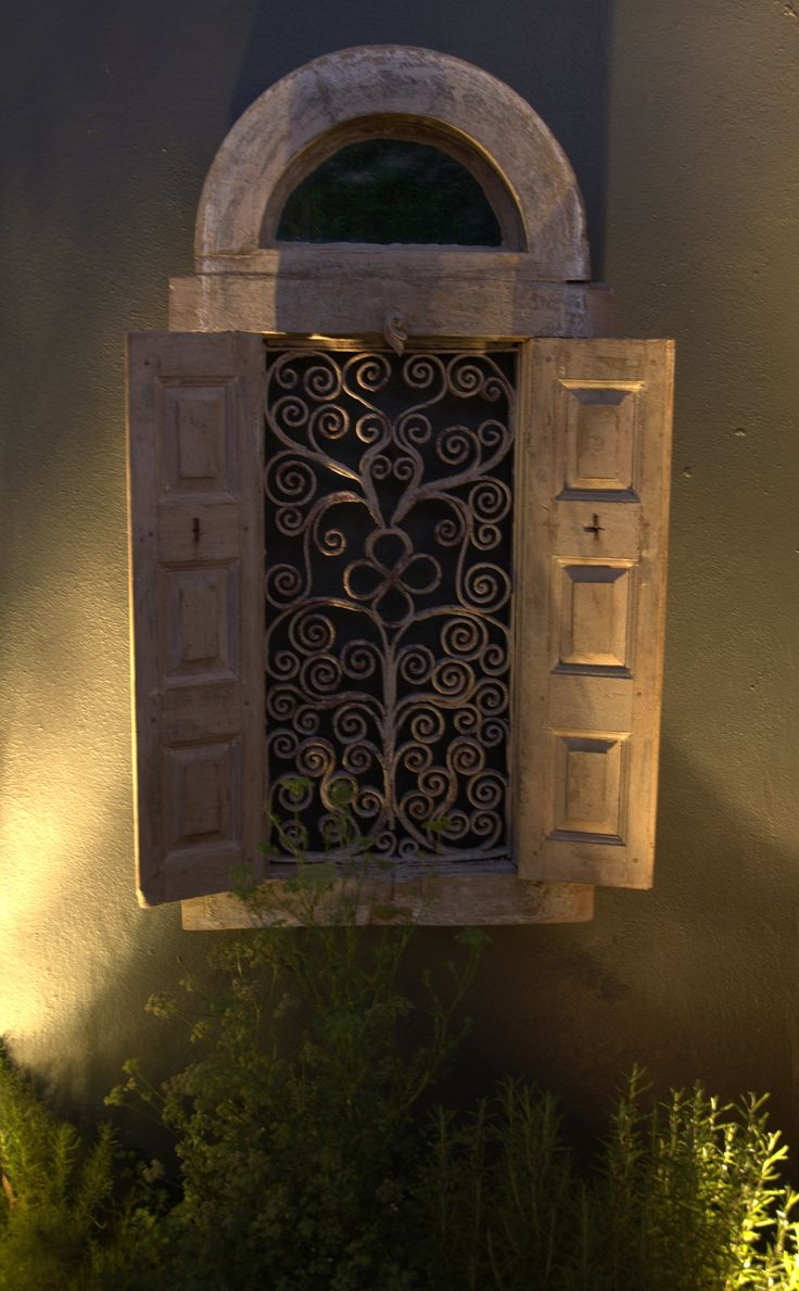 Antique window decorates the garden wall  #GardenDesignSmall
