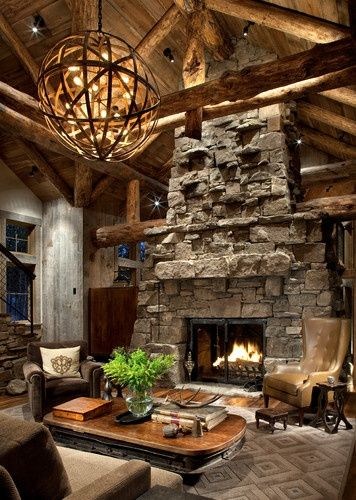 A Living Room In A Rustic Log Home Featuring A Huge Stone Fireplace And  Leather Furniture. The Look Of A Country Lodge.
