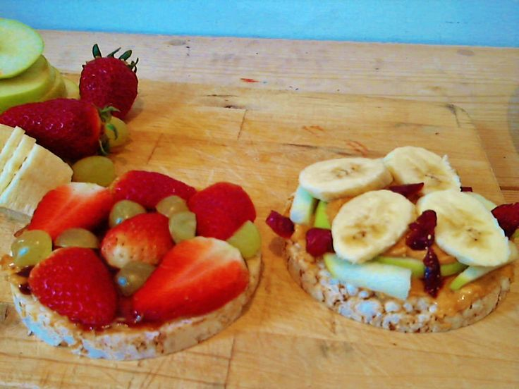 Twist on PB - plain Quaker rice cake with all natural PB and fresh fruit slices on top (sooo much better than jelly)!!