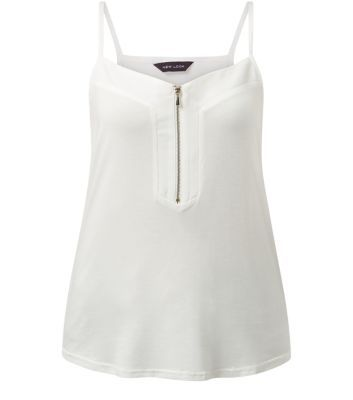 """Add some subtle detailing to a basic cami with this cream zip front design - pair with dark blue jeggings and lace up plimsolls.- Zip front detail- Shoestring straps- Scoop neckline- Casual fit- Soft finish- Model is 5'8""""/176cm and wears UK 10/EU 38/US 6"""