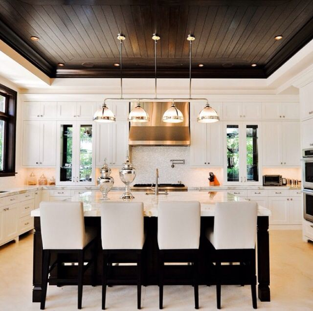 Black and white kitchen, wood ceiling