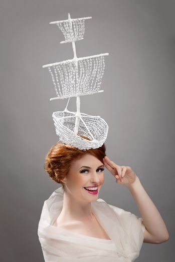 This fabulous and striking hat features a sailing boat design created from white beadwork. It would be spectacular at Royal Ascot.