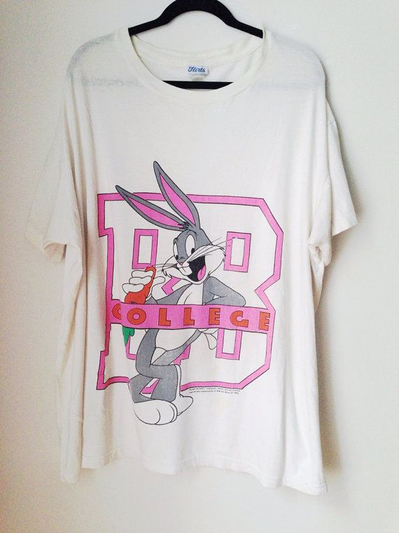 Vintage Bugs Bunny College t-shirt from 1993. Oversized shirt with large graphic on front. No size tag, but figs like a Large. In good