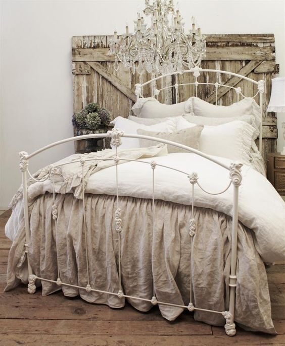weathered wood headboard, vintage metal bed and shabby chic textiles