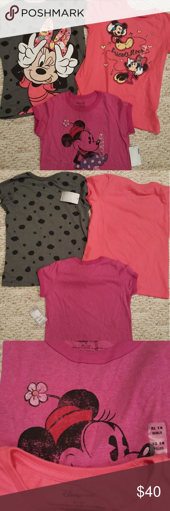 """Disney """"Bundle"""" 3 Minnie Mouse T-shirts NWT!! Three adorable Minnie Mouse T-shirts. Size XL (14)....1. Grey with black shape spot, Minnie is winking. She has one of her fabulous pink bows on with words and characters, too. Shirt 2. Coral in color with Mickey & Minnie jamming with connected headphones and """"Friends Rock"""" is scripted between them. Shirt 3. Old fashioned Minnie wearing her flowered hat and yellow clog heels on a pink T-shirt. All T-shrts should make magic in any girls heart! All…"""
