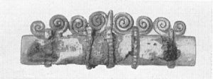 Needlecase from a mid/late 10th c. woman's grave, Birka. Length 5 cm. Phila's stringpage details her process for recreating this. Note that the silver and this level of detail is highest status.