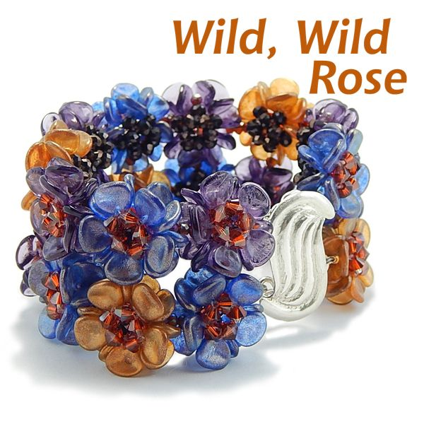 Wild, wild roses all in a row to create a bracelet cuff that makes a statement every time you put it on. There is loads of bling as well, for each rose center is created from five Swarovski crystals in deep rich burnt orange. The color doesn't stop with the rose centers with rose petals in sapphire, amethyst and amber interspersed throughout the bracelet cuff. #artjewelry #naturelover #braceletcuff #joyousjewelry