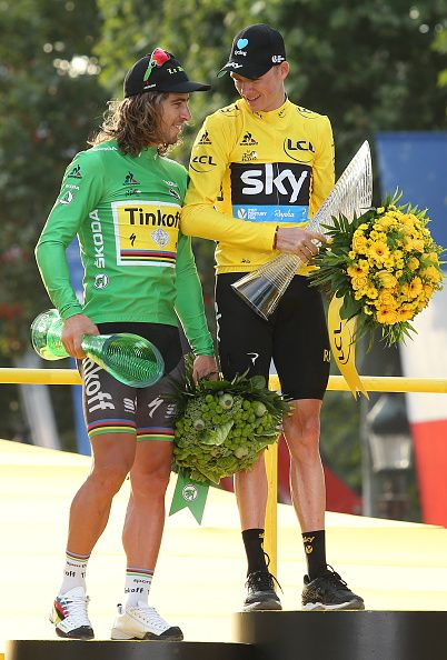 Peter Sagan of Slovakia and Tinkoff winner of the green jersey of best sprinter talks to Chris Froome of Great Britain and Team Sky winner of the...
