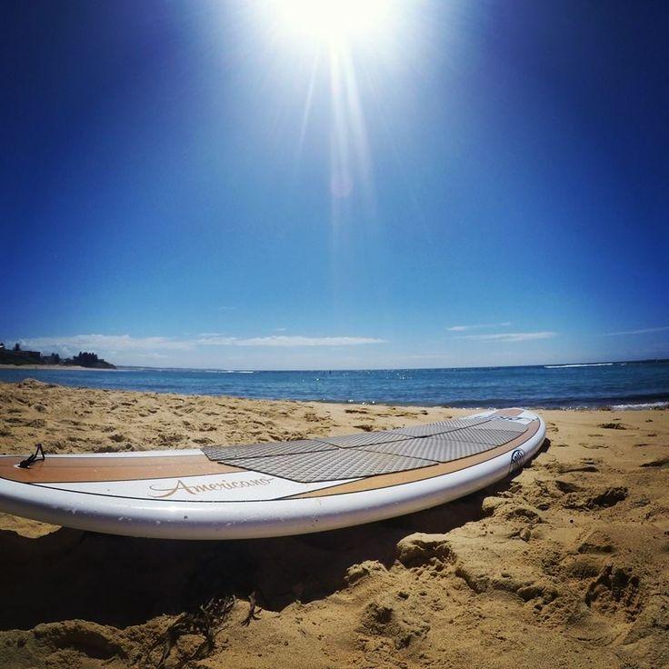 Drift Natural wood paddle board sitting at Toowoon Bay NSW Australia