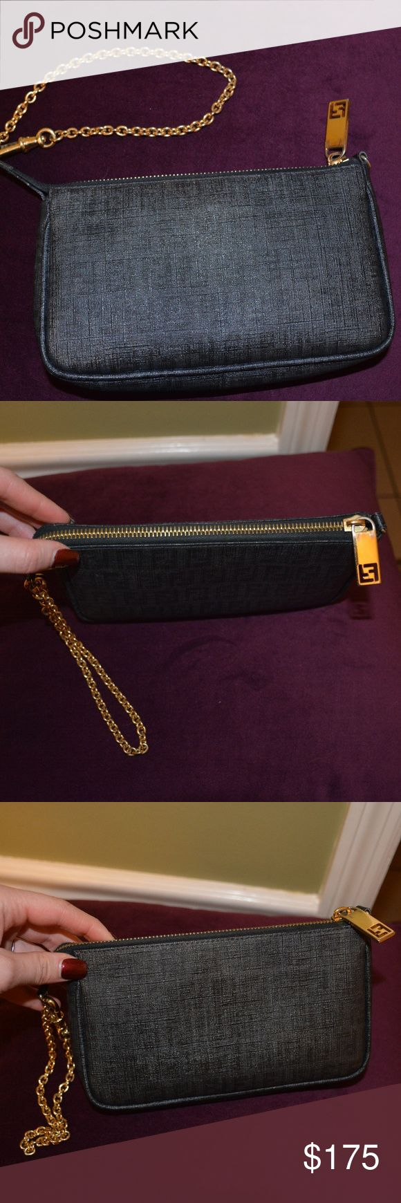 "FENDI ""Forever"" Zucchino Pouchette clutch/wristlet Authentic FENDI clutch with classic, subtle FENDI logos 7.5"" x 4.25"" x 1.25"" Gold hardware includes wristlet chain and 1.5"" gold zipper handle with FENDI logo Includes label of authenticity, RFID label and ""FENDI Made in Italy"" label attached to inside cloth (all pictured) Inside includes open credit card pocket (pictured) Very gently used and in great shape with durable leather! Signs of wear on zipper and zipper handle - functions well but…"