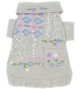 Designer Dog Sweater Little Miss Perfect Oscar Newman This beautiful pet sweater offers classic, preppy style with an air of sophistication, timeless flair with cable knit block pattern. Details include patch pocket adorned with hand-embroidered flowers and hand-beaded sequins. Shimmering hand-sewn sequins, ribbed sleeves and knitted ruffle hem adds the perfect finishing touches to this perfect little puppy sweater.