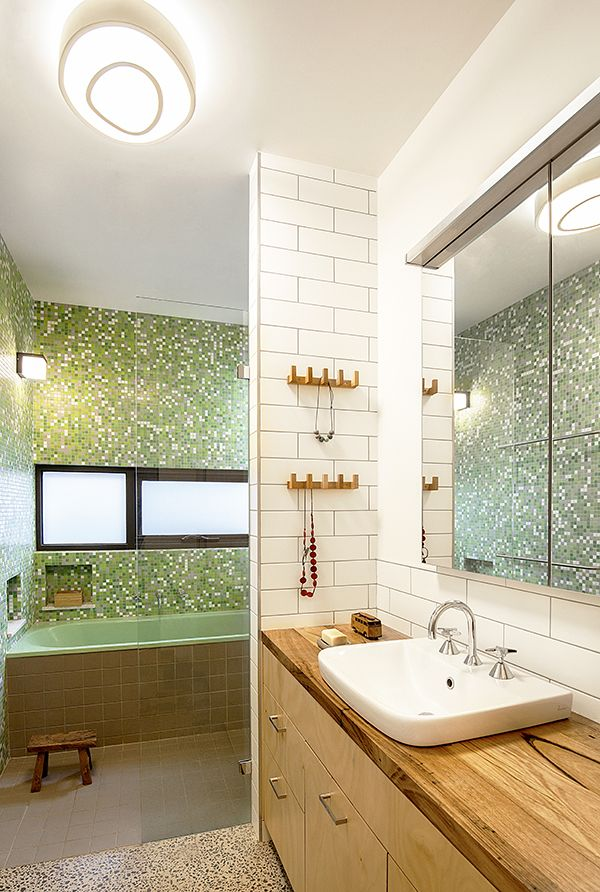 There are far fewer appliances in a bathroom compared to a kitchen, but radiant heat lamps and heated towel rails have the ability to use a lot of energy if they are not used correctly. Remember, it's not just the power rating of an appliance, but how long it runs for each day that determines its overall energy use. This bathroom also houses the washing machine opposite the vanity. Image: Hilary Bradford