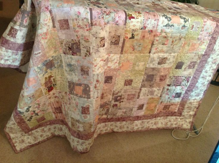 My first quilt. Using a jelly roll of'Mary rose' fabrics I created this subtle, almost antique looking quilt for my daughter.  I will always remember making this quilt: there was a two month delay when our lounge ceiling collapsed just after I'd spent several hours laying out the blocks in a suitable pattern....