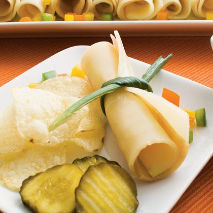 Just a slice of cheese and turkey rolled up and tied together with a green onion to look like an official DIPLOMA!
