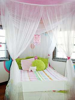Create a Bed Canopy for your child room, for an easy way to jazz up a plain bed. A bed canopy not only adds a touch of drama, but it's also cosy to sleep under. You can make them as plain or as dec...