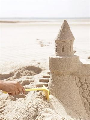 Build the best sand castle on the beach.