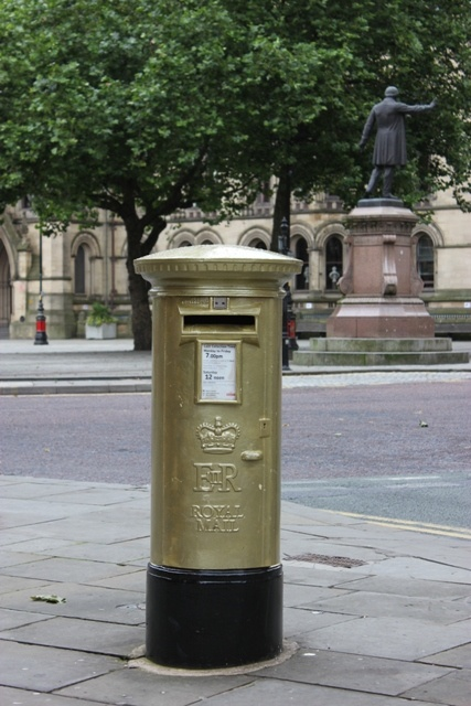 Gold pillar box outside the Town Hall in Manchester. Believed to have been re-painted in honour of Jason Kenny's cycling gold medal at London 2012.   [Copyright Avis Exley - I'd love you to share but please credit xx]