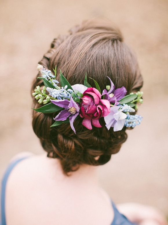 instead of having your bridesmaids carry flowers, pin them in their hair